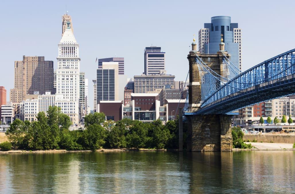 'Picture of downtown Cincinnati skyline, John A. Roebling bridge, and Cincinnati city office buildings including Great American
