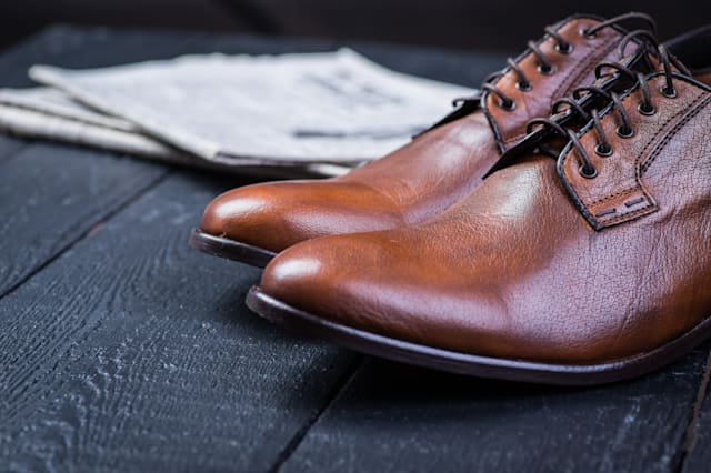 a pair of brown leather shoes...