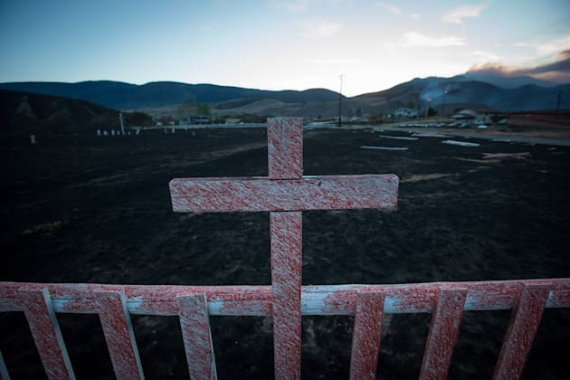 Fire retardant coats a cross at a cemetery on the Ashcroft First Nation where numerous homes were destroyed...