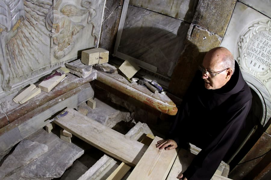 A Franciscan friar looks at the exposed the Tomb of Jesus, where his body is believed to have been laid,...