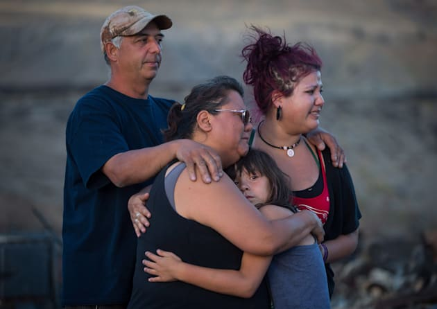 Randy Thorne, left, his wife Angie, second left, their daughter Kelsey, and granddaughter Nevaeh, 8,...