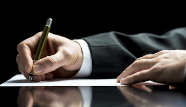 businessman writing a letter ...