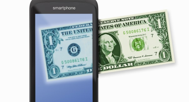 Generic smartphone with US dollar note