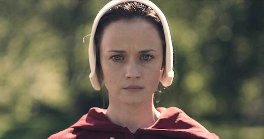 "THE HANDMAID'S TALE -- ""Offred"" - Episode 101 - Offred, one the few fertile women known as Handmaids in the oppressive Republic of Gilead, struggles to survive as a reproductive surrogate for a powerful Commander and his resentful wife. Ofglen (Alexis Bledel), shown. (Photo by: Take Five/Hulu)"