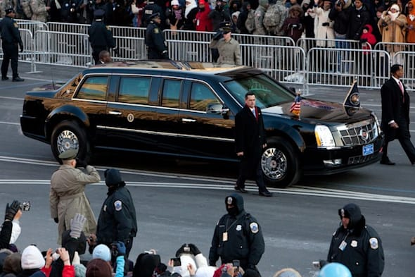 WASHINGTON - JANUARY 20: A limousine carrying President Barack Obama drives in the Inaugural Parade down Pennsylvania Avenue on January 20, 2009 in Washington, DC. Obama was sworn in as the 44th President of the United States, becoming the first African American to be elected President of the US. (Photo by Brendan Hoffman/Getty Images)