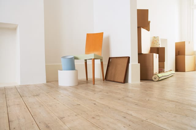 stack of moving boxes and chair ...