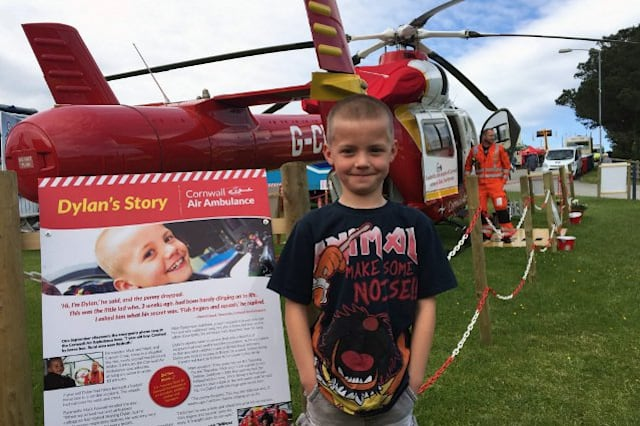 Dylan Kneebone by the ambulance that saved his life
