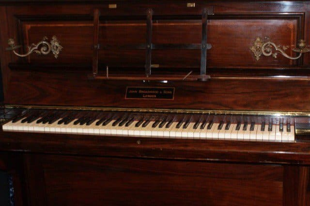 The piano in which the coins were found.