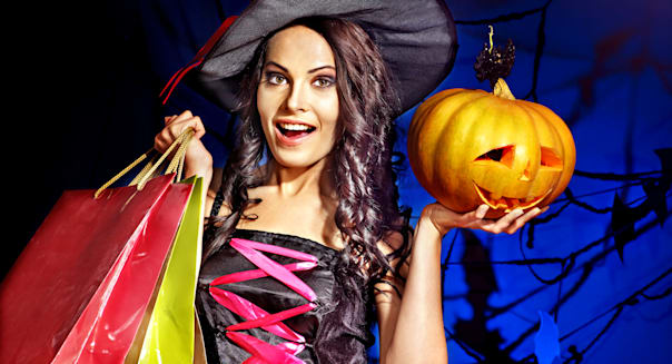 happy woman holding halloween...