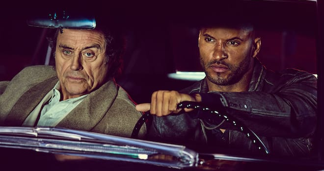 "Mr Wednesday (Ian McShane) and Shadow Moon (Ricky Whittle) in Starz's ""American Gods"""