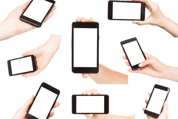 hands holding smart phones...