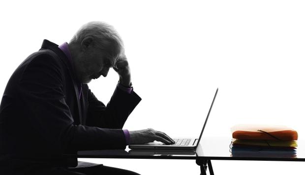 senior business man computing silhouette