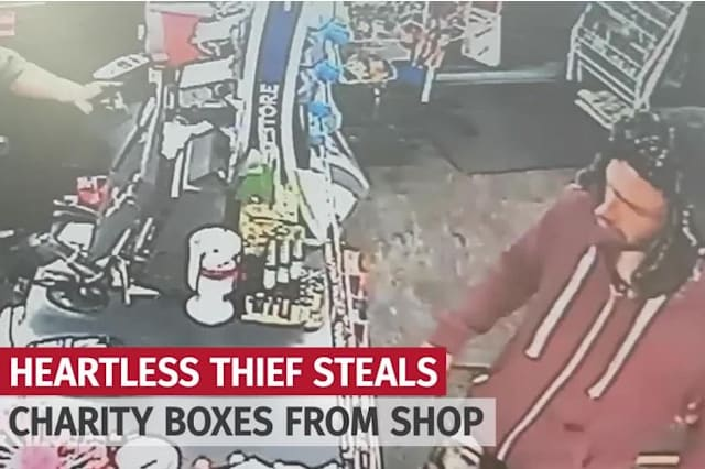 Brazen thief steals two charity collection boxes