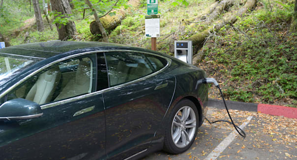 Electric car charging station with a Tesla sedan plugged in.  See description for details