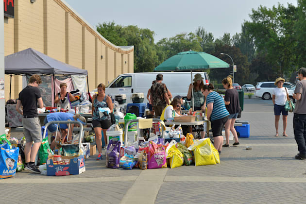 Volunteers at an evacuation centre in Kamloops, B.C. work to support residents of the nearby towns of...