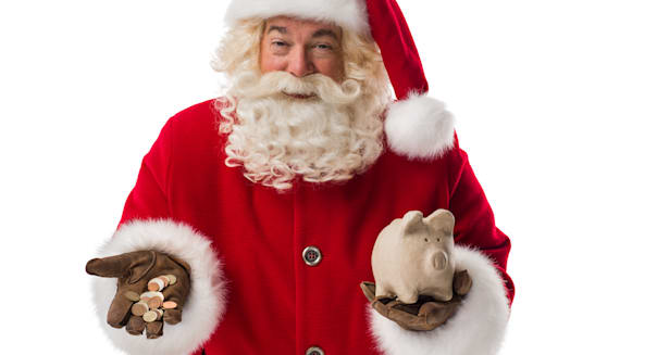 santa claus holding piggy bank...