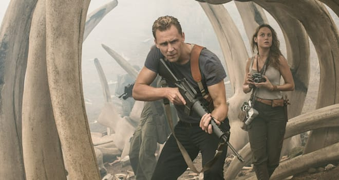 Captain James Conrad (Tom Hiddleston) and Weaver (Brie Larson) cautiously explore the boneyard in KONG: SKULL ISLAND
