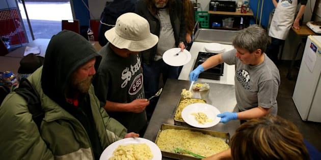 Homeless people are seen using the Meals at the Bridge Service in