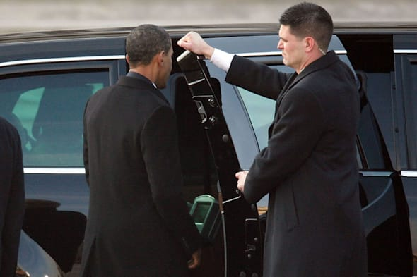 WASHINGTON - JANUARY 20:  U.S. President Barack  Obama gets into his limo after being sworn is as the 44th President of the United States of America on the East Front of the U.S. Capitol January 20, 2009 in Washington, DC. Obama becomes the first African-American to be elected to the office of President in the history of the United States.  (Photo by Max Whittaker/Getty Images) *** Local Caption *** Barack Obama