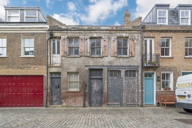 Derelict mews house on sale for high price