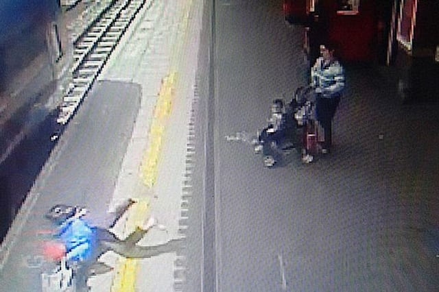 Woman dragged 60ft along train platform as hand trapped in door