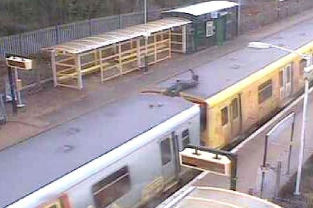 'Idiotic' superhero wannabe 'Silver Shadow' caught surfing on top of train travelling at 100mph