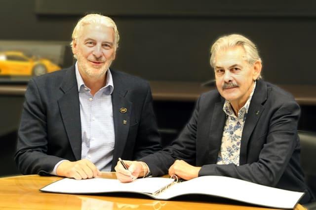 Men signing docs