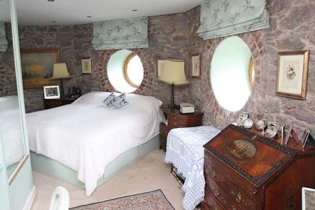 One of the bedrooms, with a circular window.