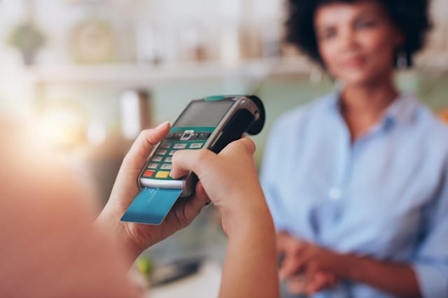 Paying for juice by credit card reader