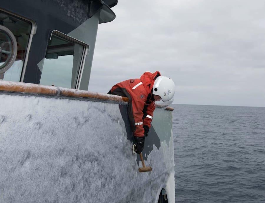 Elissa Sursara removing ice from the bridge wing of the MV Sam