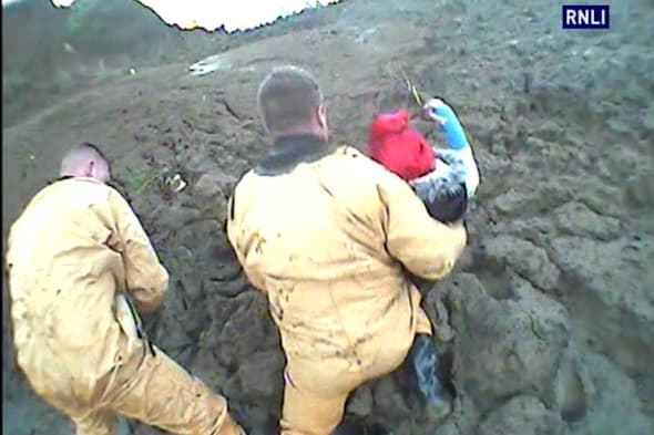 Dramatic rescue of teen girls stuck in thick mud in Kent (pics)