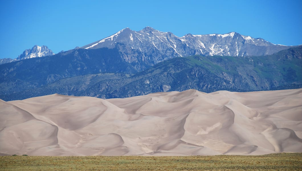 High Dunes and Crestone Peak in the background seen in Great Sand Dunes National Park, CO, USA