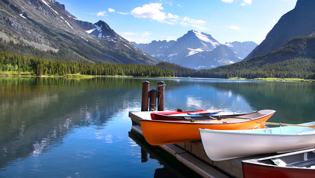 Canoes by lake Mc Donald in Glacier national park