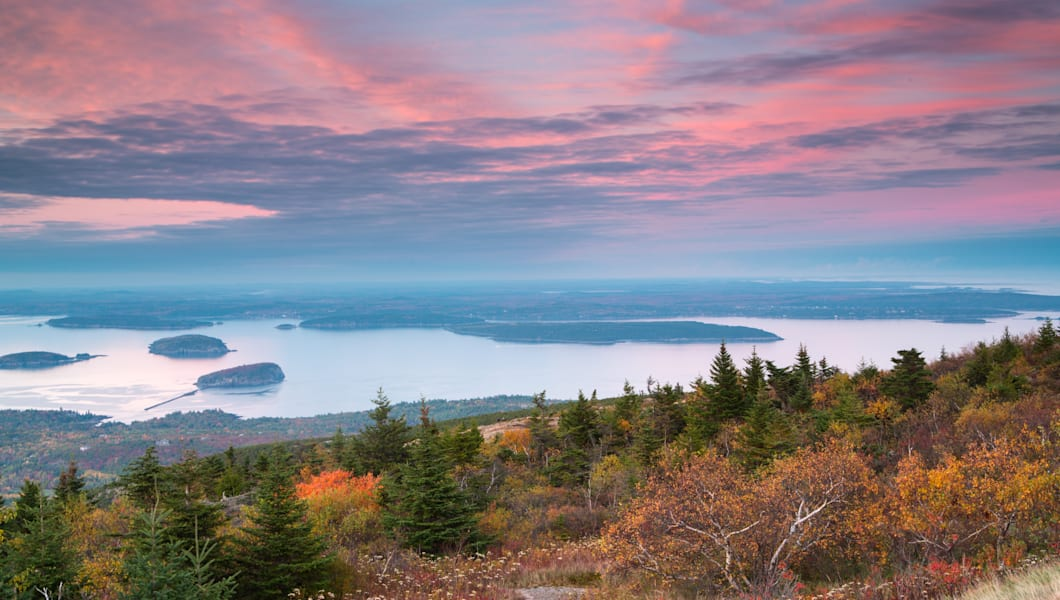 Mount Desert Island and Frenchman's Bay in Fall Foliage Season from top of Cadillac Mountain in Acadia National Park, Maine at Sunset