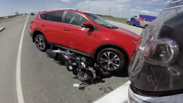 Student driver backs over motorcycle at intersection