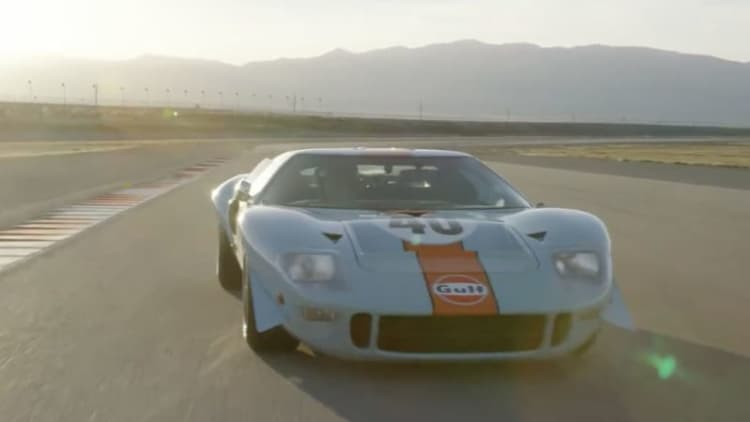 Gulf-liveried Ford GT40 takes triumphant lap of the track