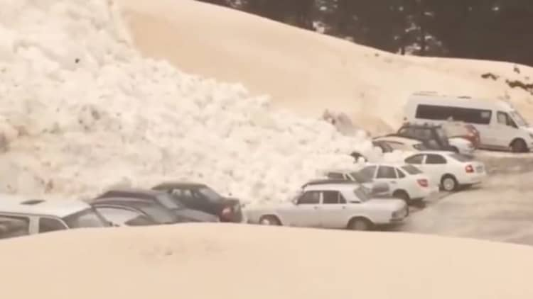 Watch a Russian avalanche bury cars