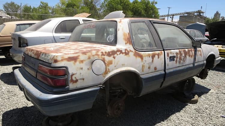 This junkyard '91 Grand Am is as hooptie as it gets