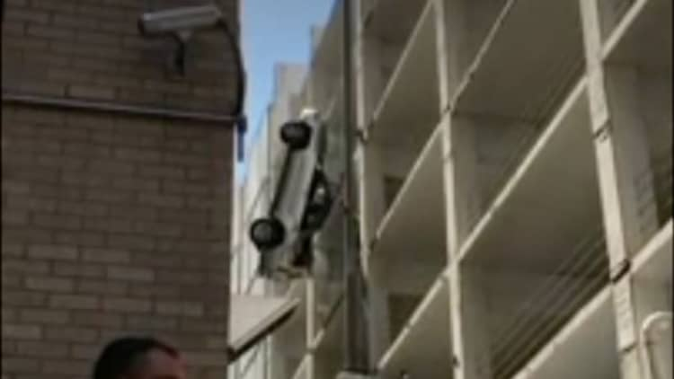 Texas man drives Toyota off the top of a parking structure