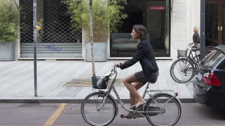 Milan considers paying people to bike to work