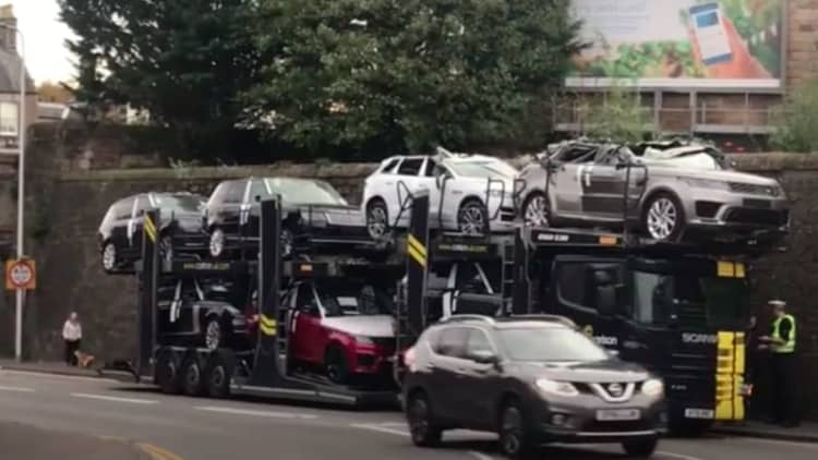 A Range Rover and a Jaguar turned into instant convertibles by bridge