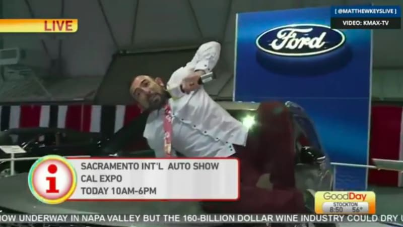 TV reporter fired after climbing on cars live at auto show