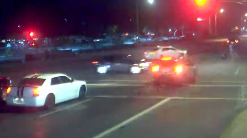 Watch speeding driver, on course to hit family with stroller, get T-boned at last second