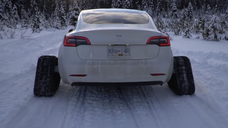 Tesla Model 3 on tracks goes clout chasing in the mountains