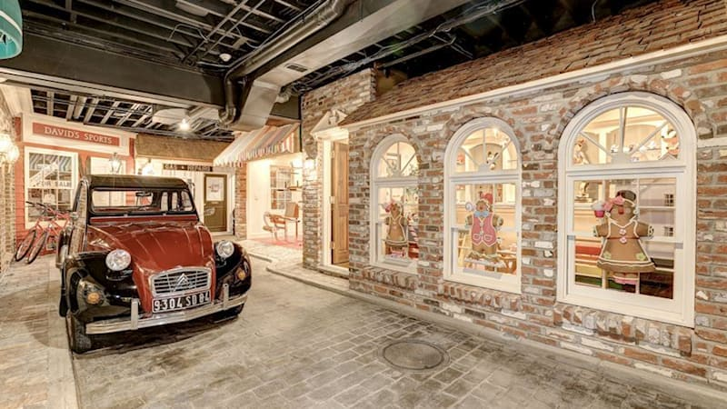 $4.5M Maryland mansion has a brick street with classic cars in its basement