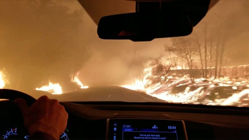 Dramatic videos show families driving through California wildfires in evacuation