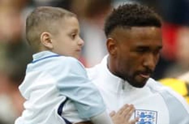 Defoe leads England on to park with terminally ill boy