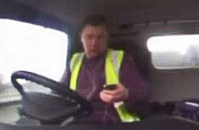 Lorry driver causes motorway pile-up while looking at his phone