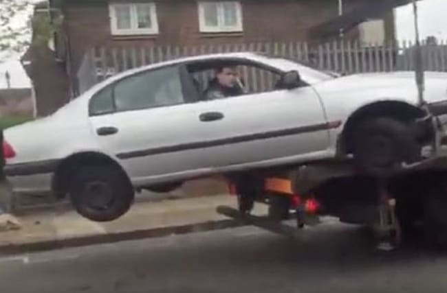This man tried and failed to drive off when his car was being towed