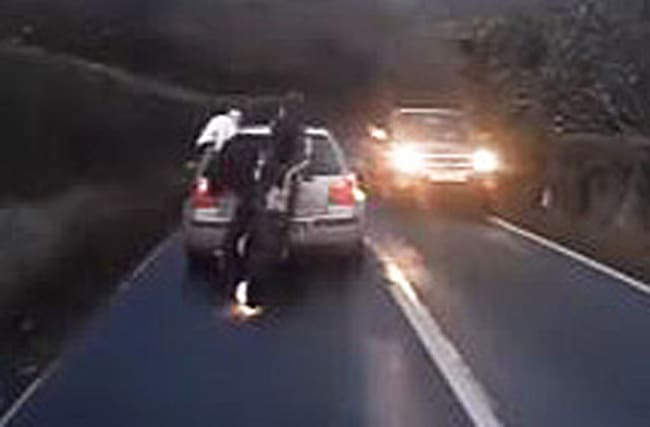 Reckless driver sends motorcyclist flying into the air